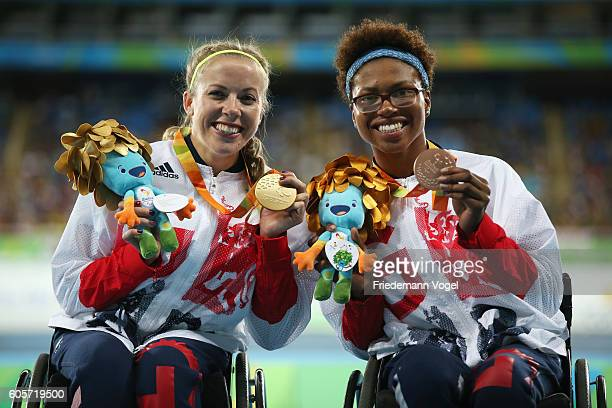 Gold medalist Hannah Cockroft and Bronze medalist Kare Adenegan of Great Britain pose for photographs after the medal ceremony for the Women's 400m...