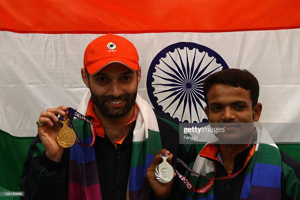 Gold medalist Harpreet Singh (L) and Silver medalist Vijay Kumar (R) of India pose with their medals following the Men's Singles 25m Centrefire Pistol at the Dr Karni Singh Shooting Range during day seven of the Delhi 2010 Commonwealth Games on October 10, 2010 in Delhi, India.