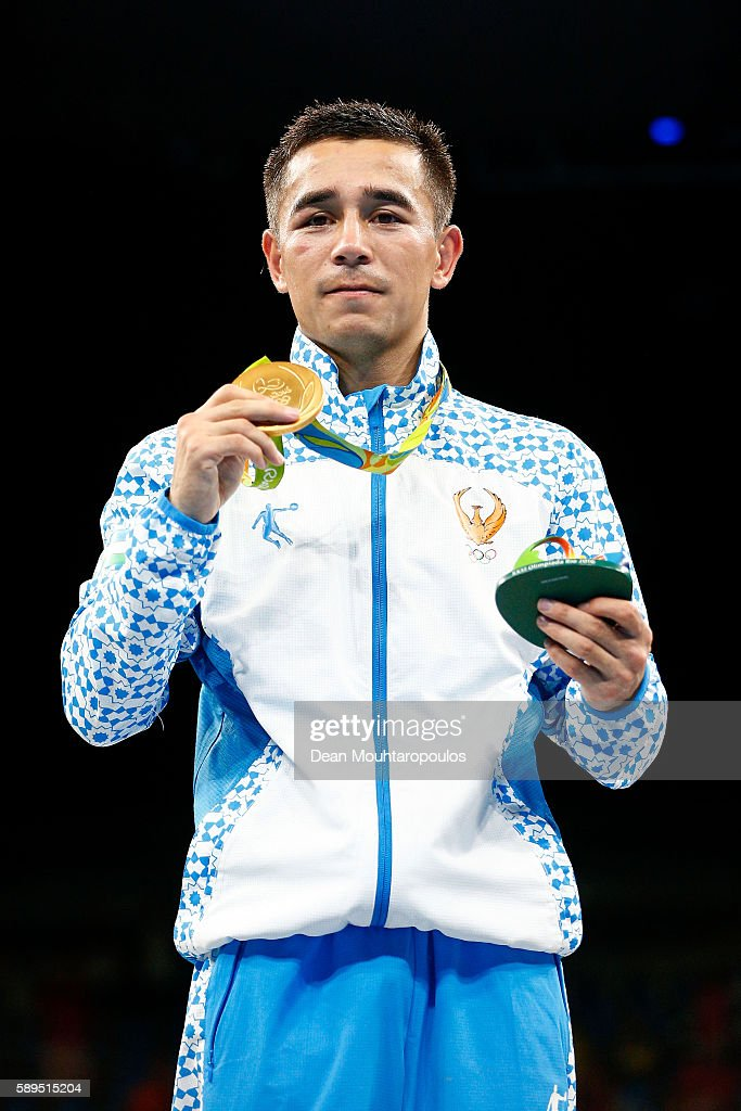 Gold medalist Hasanboy Dusmatov of Uzbekistan poses on the podium during the medal ceremony for the Men's Boxing Light Fly Final on Day 9 of the Rio...