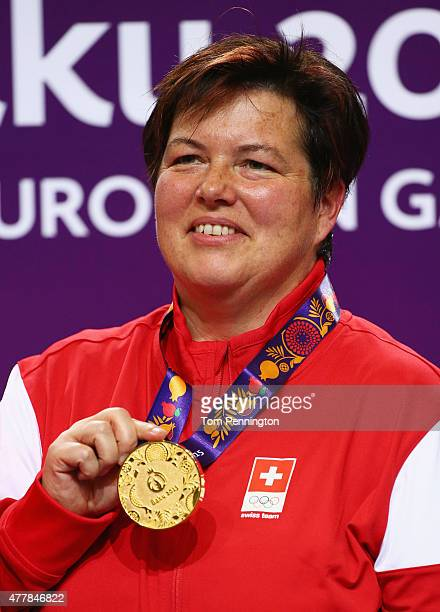 Gold medalist Heidi Diethelm Gerber of Switzerland celebrates on the podium during the Women's Pistol Shooting 25m final on day eight of the Baku...