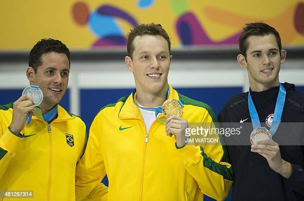 Gold medalist Henrique Rodrigues of Brazil poses with silver medalsit Thiago Pereira of Brazil and bronze medalist Joseph Bentz of USA after...
