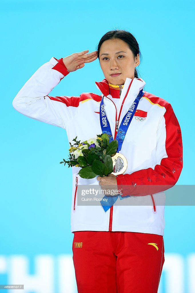Gold medalist Hong Zhang of China salutes during the medal ceremony for the Speed Skating Women's 1000m on day 7 of the Sochi 2014 Winter Olympics at Medals Plaza on February 14, 2014 in Sochi, Russia.