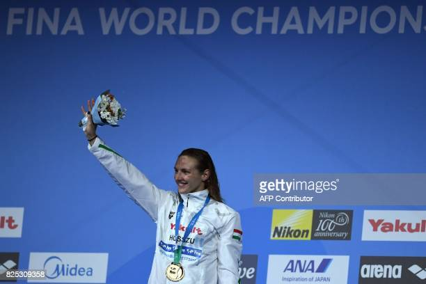 Gold medalist Hungary's Katinka Hosszu celebrates on the podium of the women's 400m individual medley during the swimming competition at the 2017...