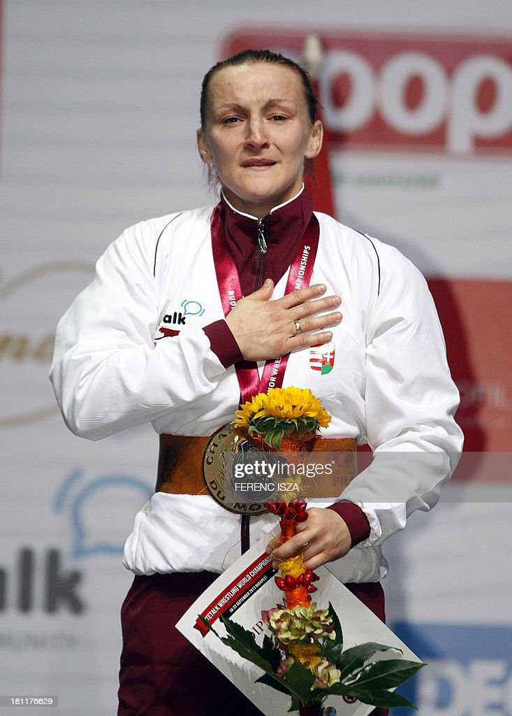 Gold medalist Hungary's Marianna Sastin celebrates on the podium of the women's free style 59 kg category of the World Wrestling Championships in Budapest on September 19, 2013.