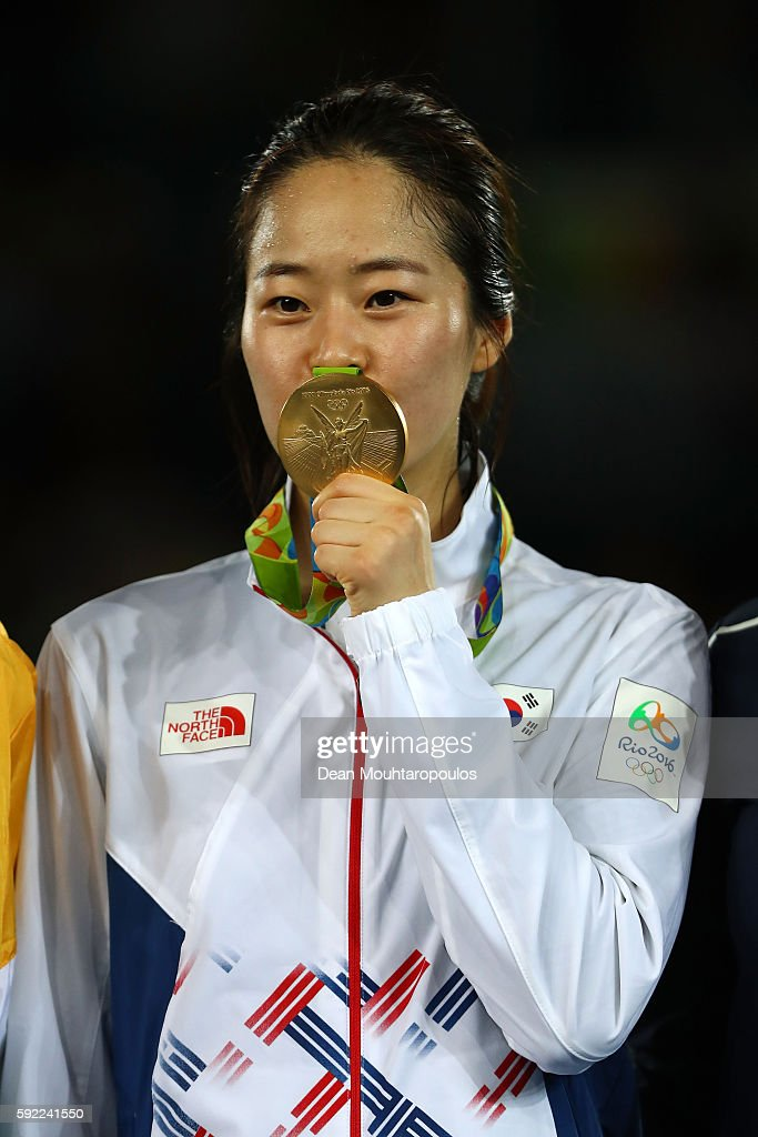 Gold medalist Hyeri Oh of South Korea poses on the podium during the medal ceremony for the Women's Taekwondo 67kg Contest on Day 14 of the Rio 2016...