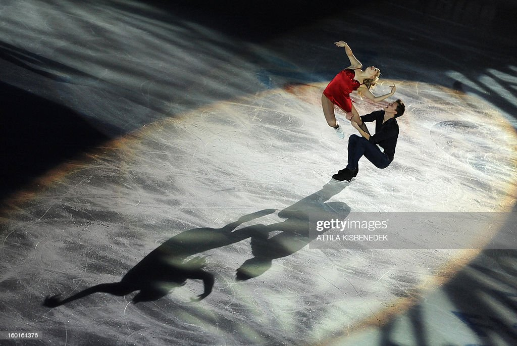 Gold medalist ice dancer pair Russian Ekaterina Boborova and Dmitri Soloviev perform on ice of Dom Sportova sports hall in Zagreb on January 27, 2013 during the gala of the ISU European Figure Skating Championships.