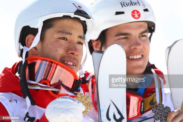 Gold medalist Ikuma Horishima of Japan and bronze medalist Mikael Kingsbury of Canada pose during the medal ceremony for the Men's Moguls on day one...