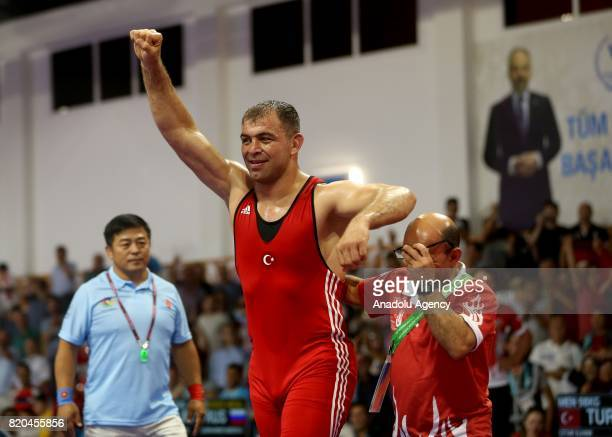 Gold medalist Ilhan Citak of Turkey celebrates after winning against Vladislav Tarasov of Russia in men's 98 kg grecoroman wrestling within the 23rd...