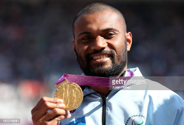 Gold medalist Iliesa Delana of Fiji poses on the podium during the medal ceremont for the Men's High Jump F42 on day 6 of the London 2012 Paralympic...