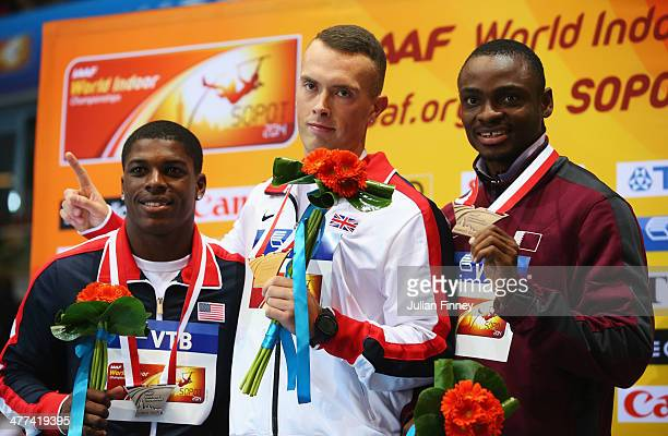 Gold medalist in the Men's 60m Richard Kilty of Great Britain poses during the medal ceremony with silver medalist Marvin Bracy of the United States...