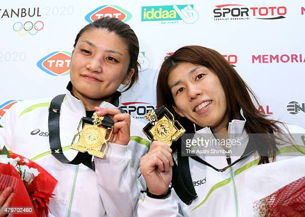Gold medalist in Women's 63kg Kaori Icho and gold medalist in Women's 55kg Saori Yoshida pose with their medals during day four of the 2011 FILA...