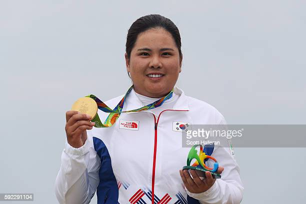 Gold medalist Inbee Park of Korea poses on the podium during the medal ceremony for Women's Golf on Day 15 of the Rio 2016 Olympic Games at the...