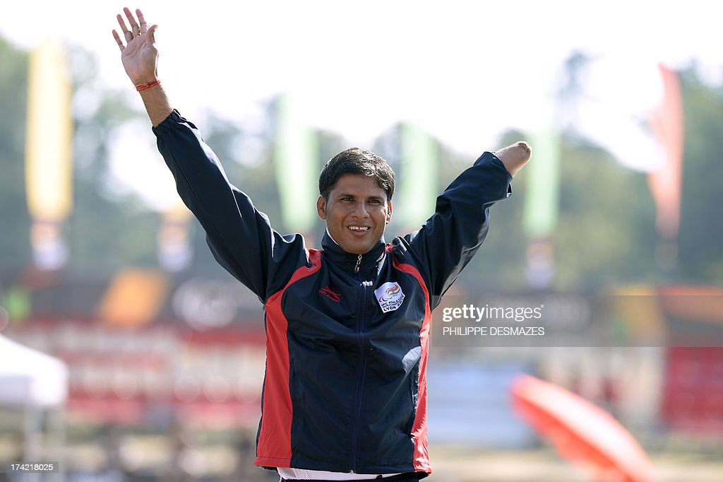 Gold medalist, Indian athlete Devendra Jhajharia, jubilates on the podium after winning the Men's Javelin Throw T46, on July 22, 2013 during of the IPC Athletics World Championships of Lyon at the Rhone Stadium in Venissieux near Lyon.