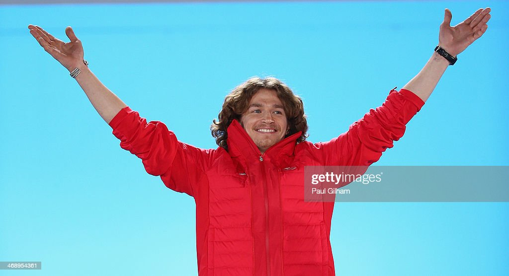 Gold medalist Iouri Podladtchikov of Switzerland celebrates during the medal ceremony for the Snowboard Men's Halfpipe on day five of the Sochi 2014 Winter Olympics at Medals Plaza on February 12, 2014 in Sochi, Russia.