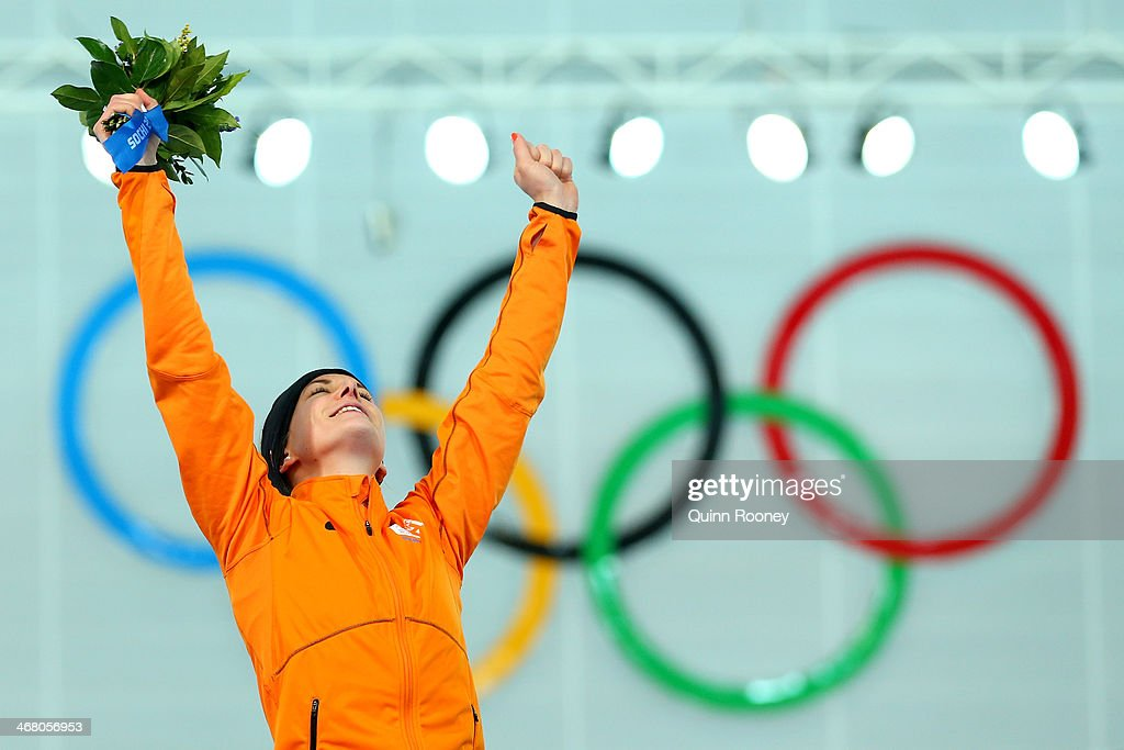 Gold medalist Irene Wust of the Netherlands celebrates on the podium during the flower ceremony for the Women's 3000m Speed Skating event during day 2 of the Sochi 2014 Winter Olympics at Adler Arena Skating Center on February 9, 2014 in Sochi, Russia.