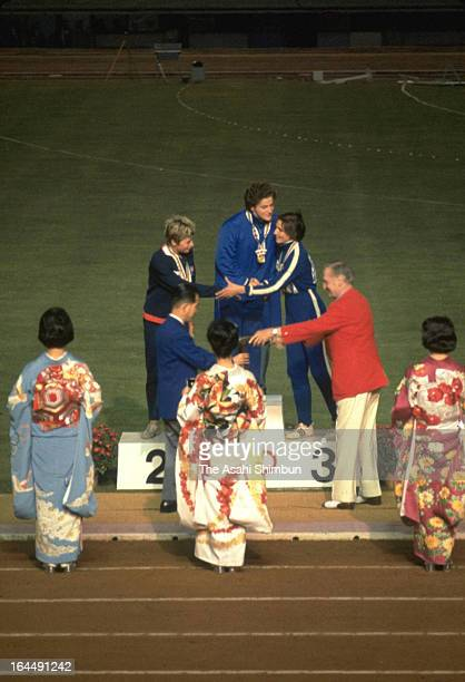 Gold Medalist Irina Press of Soviet Union Silver medalist Mary Rand of Great Britain and Galina Bystrova of Soviet Union are seen on the podium after...