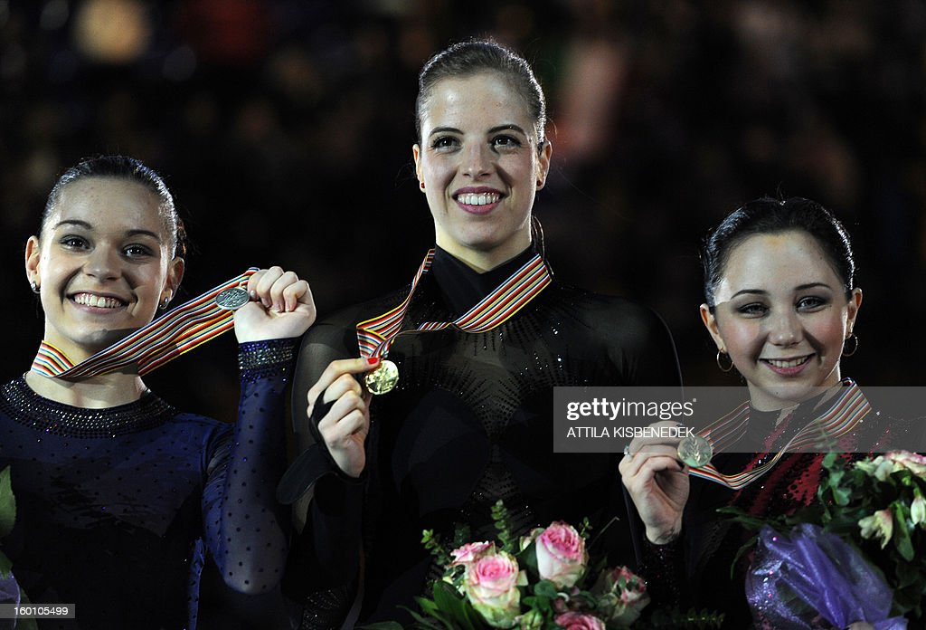 Gold medalist Italian Carolina Kostner (C) celebrates her victory beside Russians Adelina Sotnikova (L) and Elizaveta Tuktamysheva (R) on the podium in the Dom Sportova sports hall in Zagreb on January 26, 2013 after the women's free skating event of the ISU European Figure Skating Championships. AFP PHOTO / ATTILA KISBENEDEK