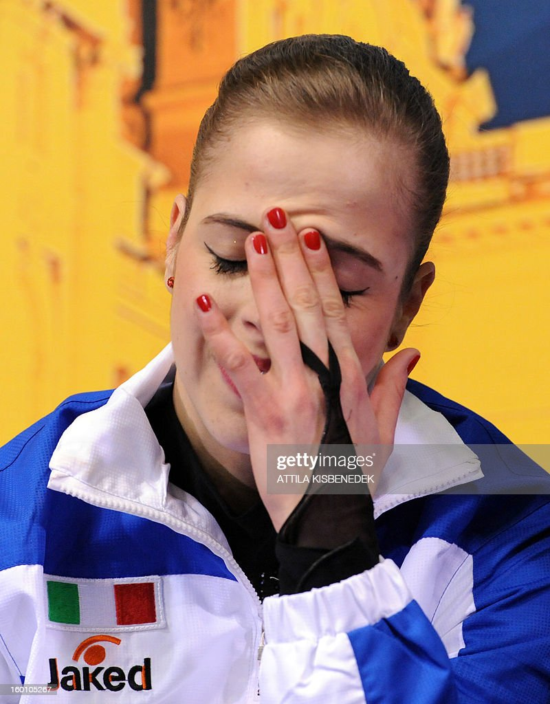 Gold medalist Italian Carolina Kostner reacts for her points in the 'Dom Sportova' sports hall in Zagreb on January 26, 2013 after the free skating for women category of the ISU European Figure Skating Championships.