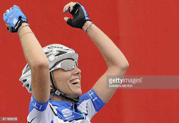 Gold medalist Italy's Tatiana Guderzo celebrates as she crosses the finish line to carry off the Women world road race championships at Mendrisio on...
