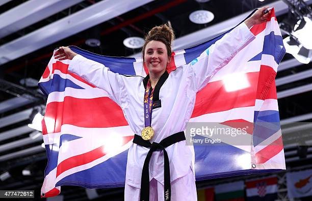 Gold medalist Jade Jones of Great Britain poses with the medal won in the Women's Taekwondo 57kg final on day five of the Baku 2015 European Games at...