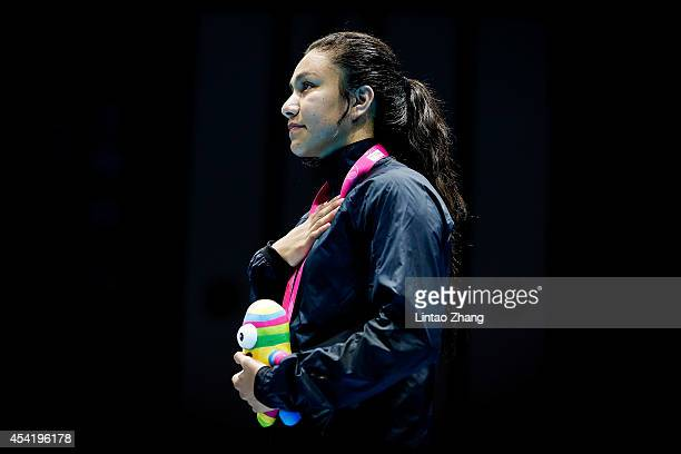 Gold medalist Jajaira Gonzalez of United States celebrates during the medal ceremony after the Women's Light Final on day ten of the Nanjing 2014...