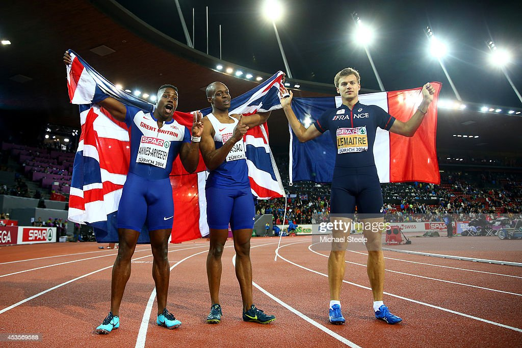 Gold medalist <a gi-track='captionPersonalityLinkClicked' href=/galleries/search?phrase=James+Dasaolu&family=editorial&specificpeople=7118567 ng-click='$event.stopPropagation()'>James Dasaolu</a> of Great Britain and Northern Ireland and bronze medalist <a gi-track='captionPersonalityLinkClicked' href=/galleries/search?phrase=Harry+Aikines-Aryeetey&family=editorial&specificpeople=247216 ng-click='$event.stopPropagation()'>Harry Aikines-Aryeetey</a> of Great Britain and Northern Ireland celebrate with a Union Jack next to silver medalist <a gi-track='captionPersonalityLinkClicked' href=/galleries/search?phrase=Christophe+Lemaitre+-+Sprinter&family=editorial&specificpeople=5431868 ng-click='$event.stopPropagation()'>Christophe Lemaitre</a> of France after the Men's 100 metres final during day two of the 22nd European Athletics Championships at Stadium Letzigrund on August 13, 2014 in Zurich, Switzerland.