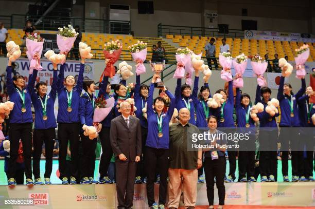Gold medalist Japan team celebrate on the podium during the 19th Asian Senior Women's Volleyball Championship 2017 awarding ceremony after beating...