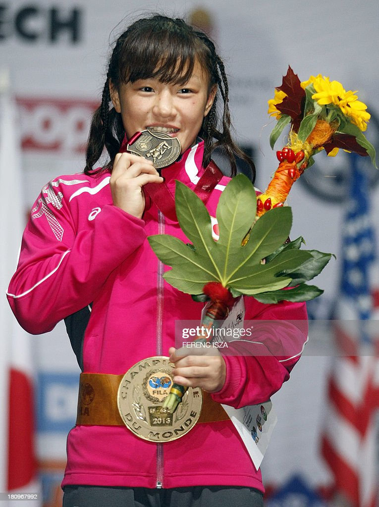 Gold medalist Japan's Eri Tosaka celebrates on the podium of the women's free style 48 kg category of the World Wrestling Championships in Budapest on September 18, 2013.