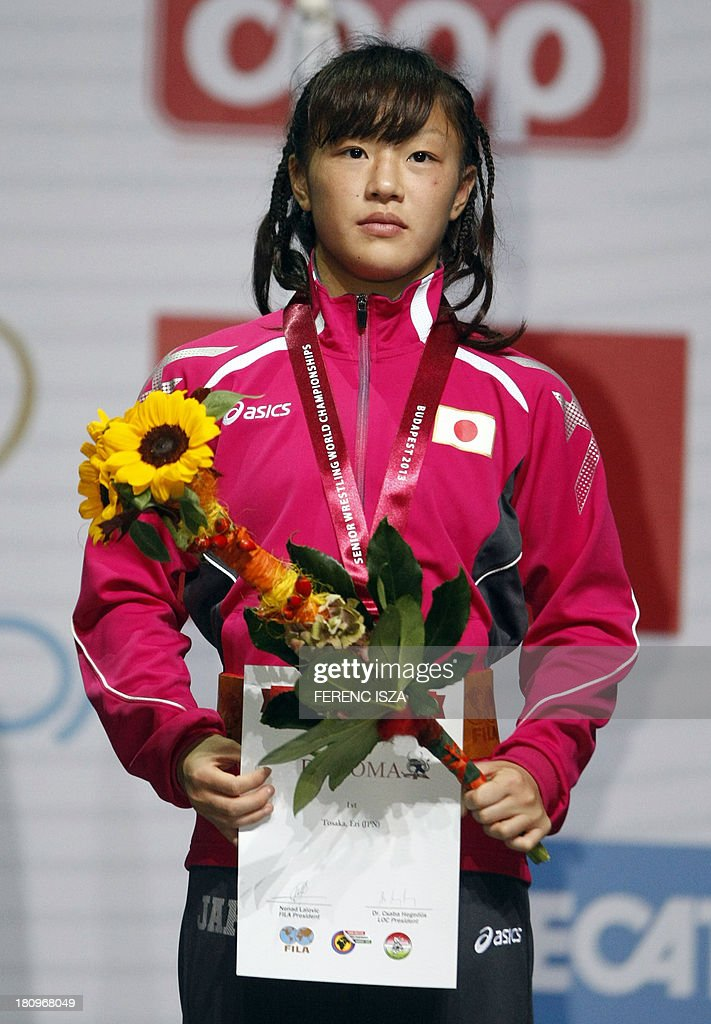 Gold medalist Japan's Eri Tosaka listens national anthem on the podium of the women's free style 48 kg category of the World Wrestling Championships in Budapest on September 18, 2013.