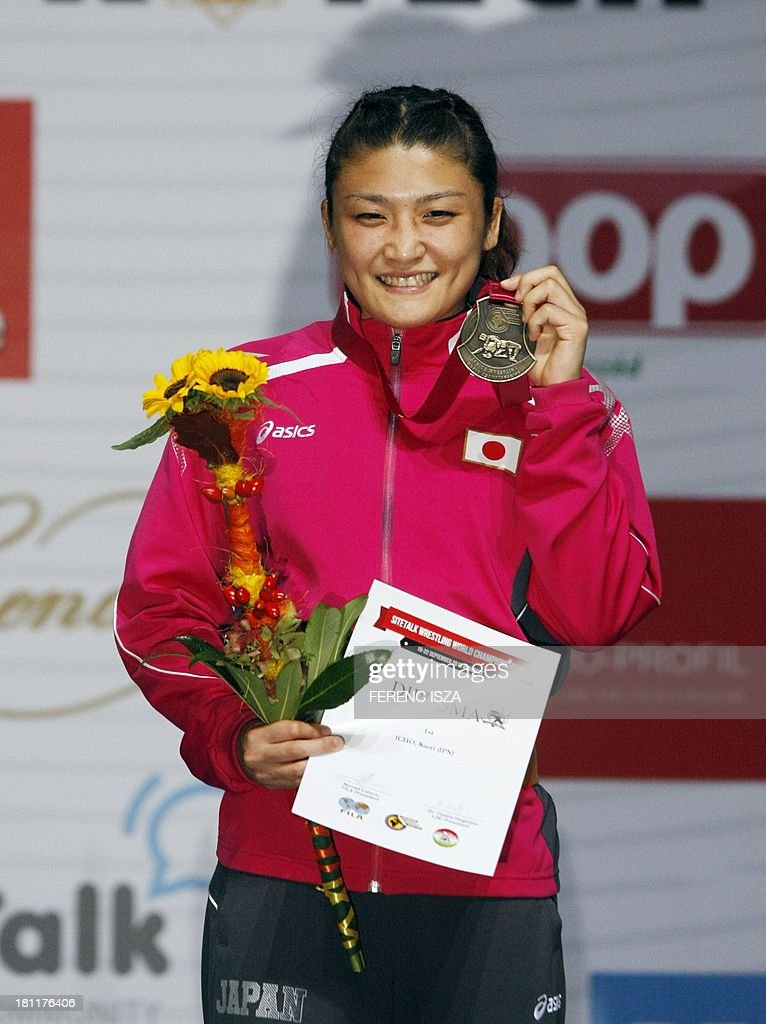 Gold medalist Japan's Kaori Icho celebrates on the podium of the women's free style 63 kg category of the World Wrestling Championships in Budapest on September 19, 2013.