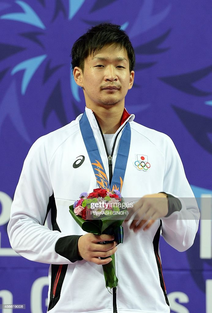 Gold medalist Japan's <a gi-track='captionPersonalityLinkClicked' href=/galleries/search?phrase=Ryutaro+Araga&family=editorial&specificpeople=7361550 ng-click='$event.stopPropagation()'>Ryutaro Araga</a> poses during the victory ceremony of the men's -84kg karate category during the 17th Asian Games at Gyeyang Gymnasium in Incheon on October 4, 2014. AFP PHOTO / PRAKASH SINGH