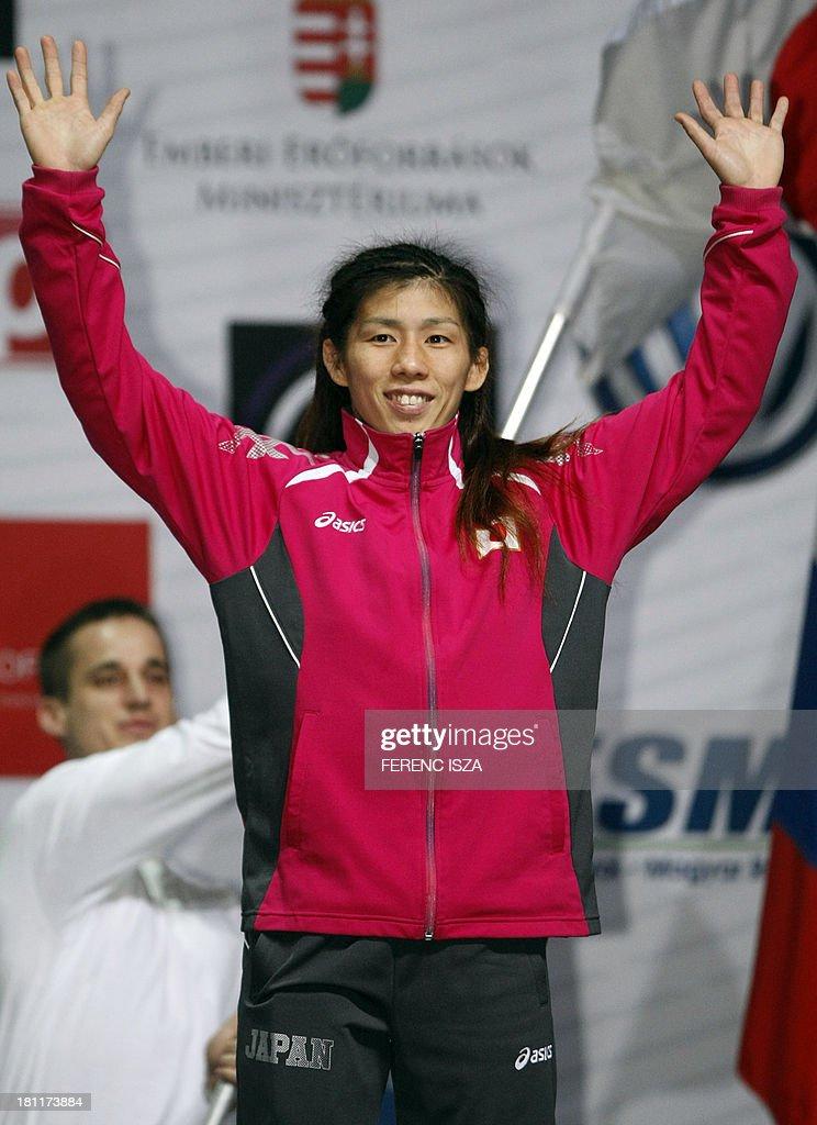 Gold medalist Japan's Saori Yoshida celebrates on the podium celebrates on the podium of the women's free style 55 kg category of the World Wrestling Championships in Budapest on September 19, 2013.