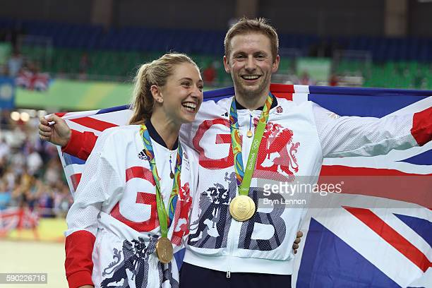 Gold medalist Jason Kenny of Great Britain celebrates with girlfriend cycling gold medalist Laura Trott of Great Britain during the medal ceremony...