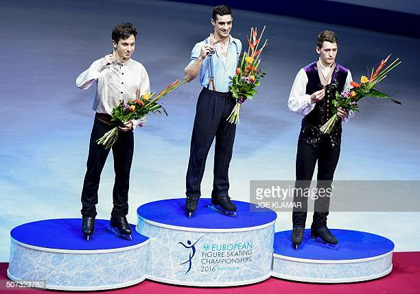 Gold medalist Javier Fernandez of Spain silver medalist Alexei Bychenko of Israel and the bronze medalist Maxim Kovtun of Russia pose at the podium...