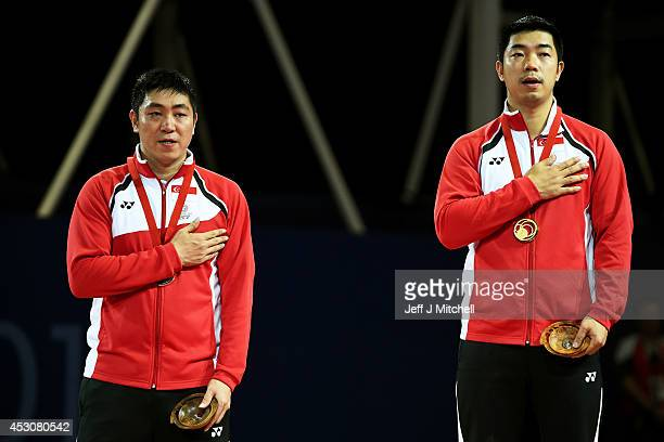 Gold medalist Jian Zhan of Singapore poses with silver medalist Ning Gao of Singapore during the medal ceremony for the Men's Singles Final at...