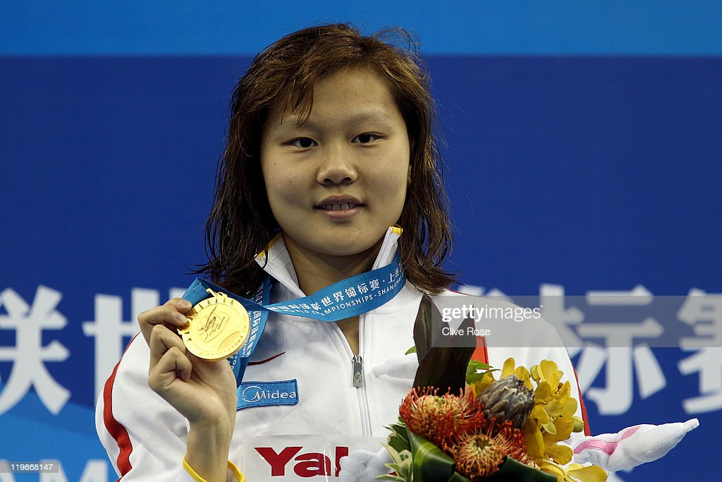 Gold medalist Jing Zhao of China poses after the Women's 100m Backstroke Final during Day Eleven of the 14th FINA World Championships at the Oriental Sports Center on July 26, 2011 in Shanghai, China.