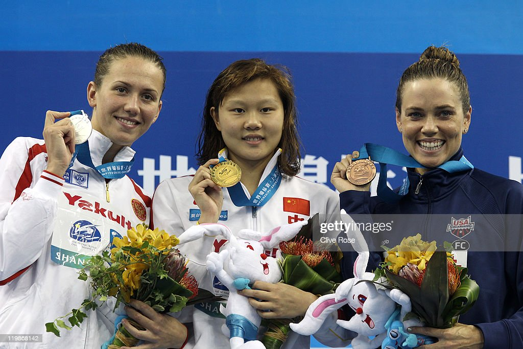 Gold medalist Jing Zhao (C) of China poses with silver medalist <a gi-track='captionPersonalityLinkClicked' href=/galleries/search?phrase=Anastasia+Zueva&family=editorial&specificpeople=4210841 ng-click='$event.stopPropagation()'>Anastasia Zueva</a> (L) of Russia and bronze medalist <a gi-track='captionPersonalityLinkClicked' href=/galleries/search?phrase=Natalie+Coughlin&family=editorial&specificpeople=171726 ng-click='$event.stopPropagation()'>Natalie Coughlin</a> of the United States after the Women's 100m Backstroke Final during Day Eleven of the 14th FINA World Championships at the Oriental Sports Center on July 26, 2011 in Shanghai, China.