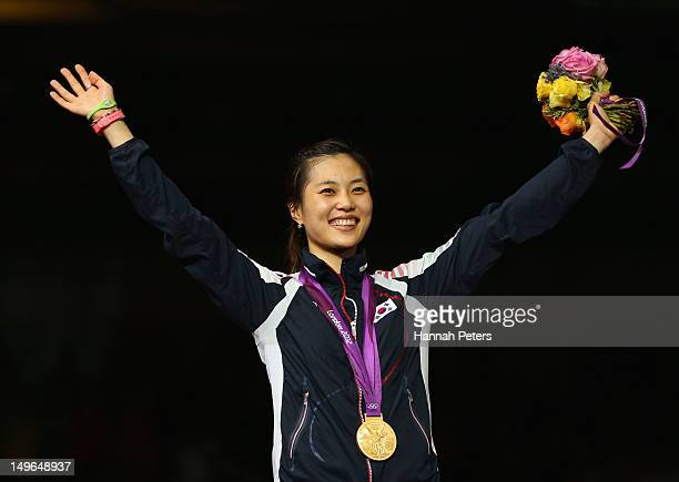 Gold medalist Jiyeon Kim of Korea poses on the podium during the medal ceremony in the Women's Sabre Individual Fencing Gold on Day 5 of the London...