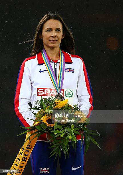 Gold medalist Jo Pavey of Great Britain and Northern Ireland poses during the medal ceremony for the Women's 10000 metres final during day two of the...