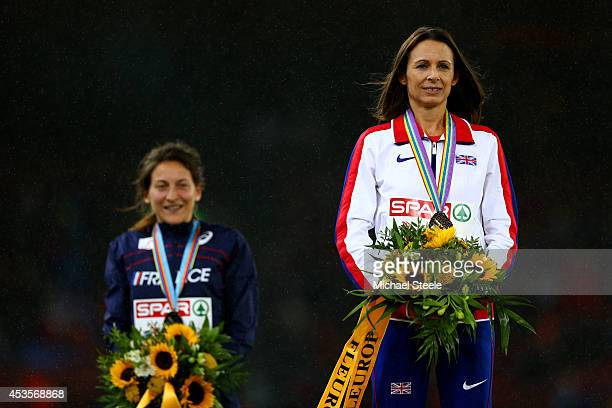 Gold medalist Jo Pavey of Great Britain and Northern Ireland poses next to silver medalist Clemence Calvin of France during the medal ceremony for...