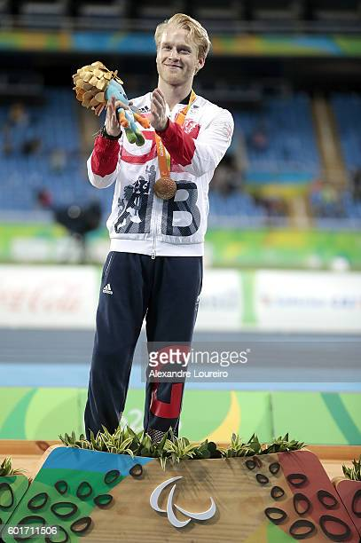 Gold medalist Jonnie Peacock of Great Britain celebrate on the podium at the medal ceremony for the Menâs 100m â F44 Final during day 2 of the Rio...
