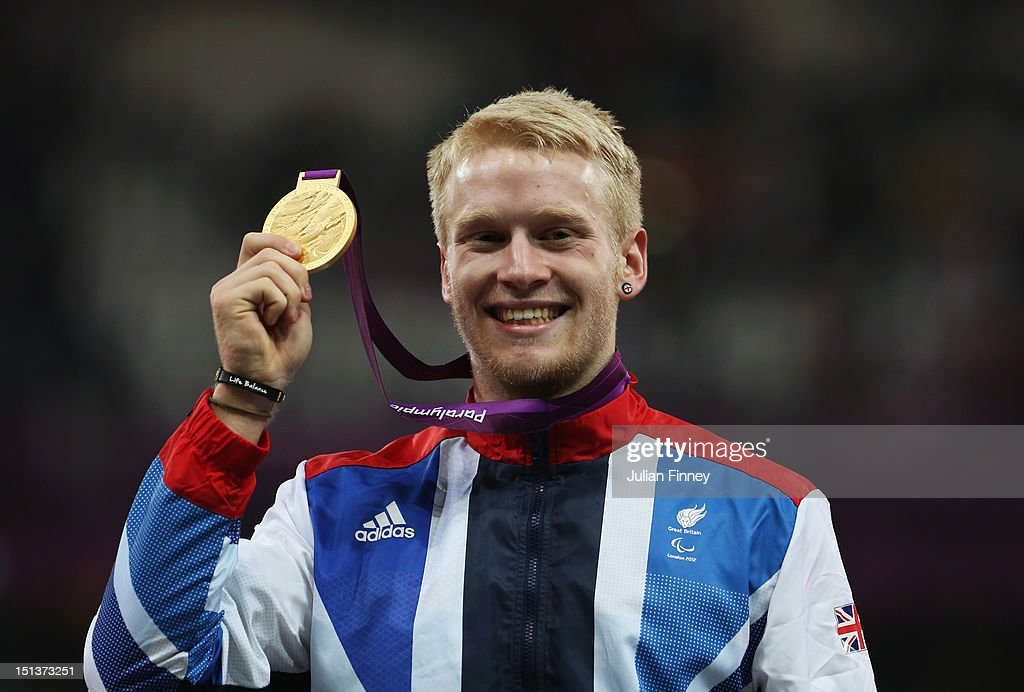 Gold medalist <a gi-track='captionPersonalityLinkClicked' href=/galleries/search?phrase=Jonnie+Peacock&family=editorial&specificpeople=7441025 ng-click='$event.stopPropagation()'>Jonnie Peacock</a> of Great Britain poses on the podium during the victory ceremony for the Men's 100m - T44 on day 8 of the London 2012 Paralympic Games at Olympic Stadium on September 6, 2012 in London, England.