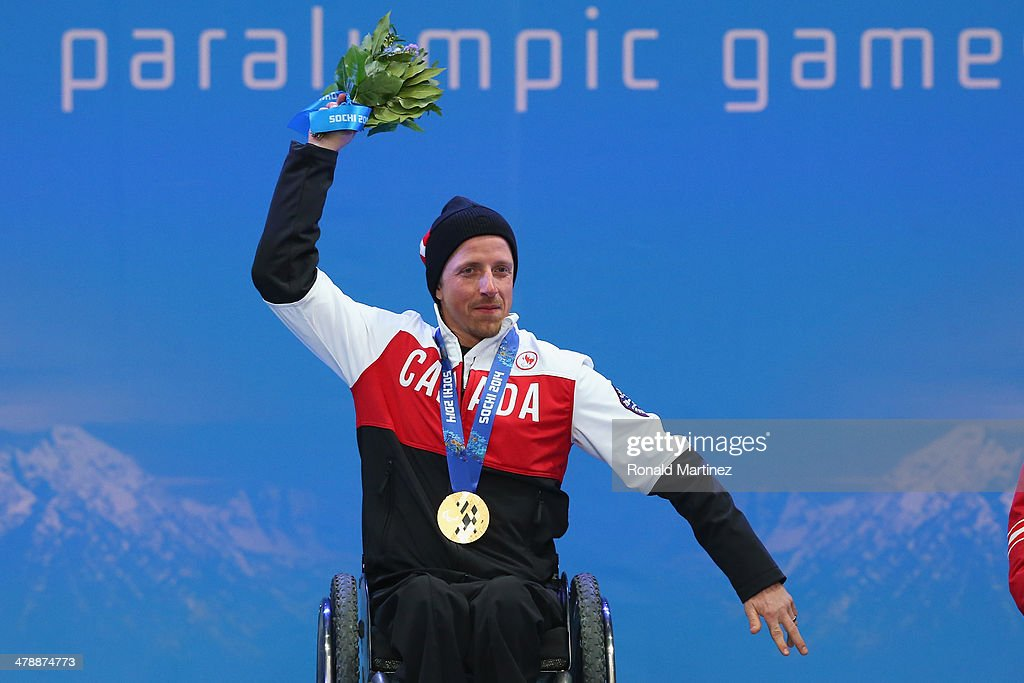 Gold medalist Josh Dueck of Canada celebrates at the medal ceremony for men's Super Combined Sitting on day eight of the Sochi 2014 Paralympic Winter Games at Laura Cross-country Ski & Biathlon Center on March 15, 2014 in Sochi, Russia.