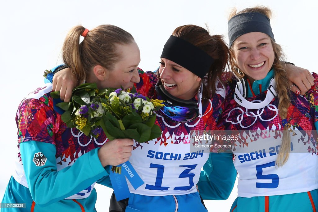 Gold medalist <a gi-track='captionPersonalityLinkClicked' href=/galleries/search?phrase=Julia+Dujmovits&family=editorial&specificpeople=4698927 ng-click='$event.stopPropagation()'>Julia Dujmovits</a> (C) of Austria celebrates with silver medalist Anke Karstens (L) of Germany and bronze medalist <a gi-track='captionPersonalityLinkClicked' href=/galleries/search?phrase=Amelie+Kober&family=editorial&specificpeople=869316 ng-click='$event.stopPropagation()'>Amelie Kober</a> (R) of Germany in the Snowboard Ladies' Parallel Slalom Big Final on day 15 of the 2014 Winter Olympics at Rosa Khutor Extreme Park on February 22, 2014 in Sochi, Russia.