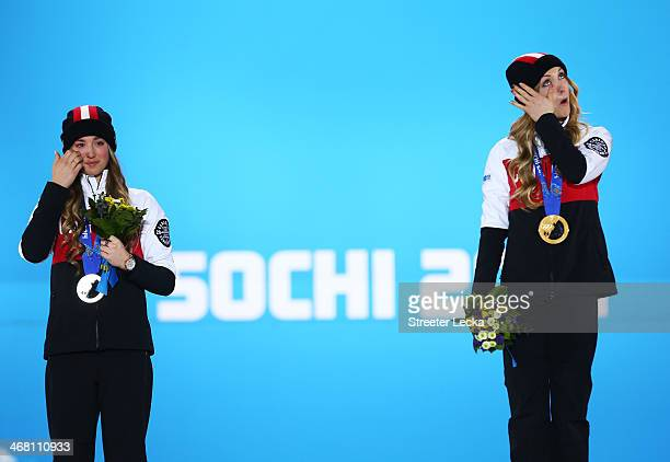 Gold medalist Justine DufourLapointe and silver medalist Chloe DufourLapointe of Canada celebrate during the medal ceremony for the Ladies' Moguls...