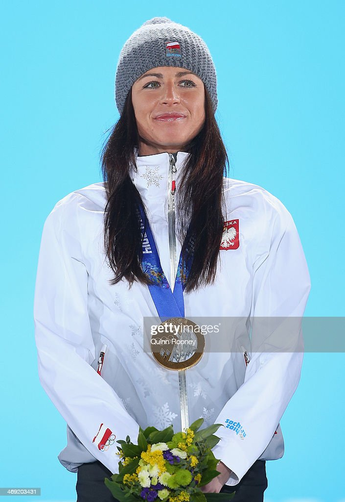 Gold medalist Justyna Kowalczyk of Poland celebrates during the medal ceremony for the Women's 10 km Classic on day six of the Sochi 2014 Winter Olympics at Medals Plaza on February 13, 2014 in Sochi, Russia.