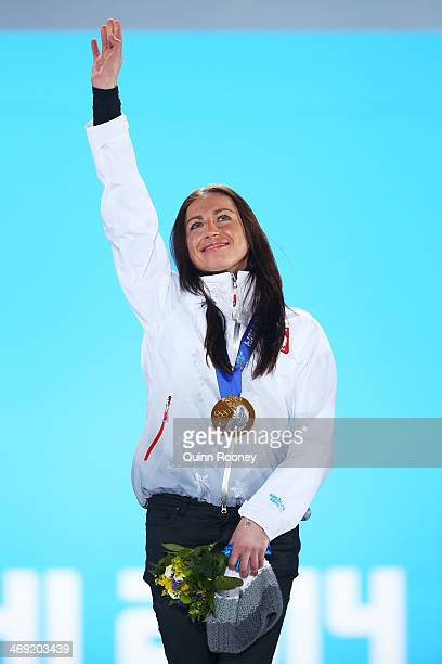 Gold medalist Justyna Kowalczyk of Poland celebrates during the medal ceremony for the Women's 10 km Classic on day six of the Sochi 2014 Winter...