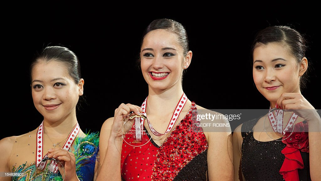 Gold medalist Kaetlyn Osmond (C) of Canada is joined by silver medalist Akiko Suzuki (L) of Japan and bronze medalist Kanako Murakami of Japan during the medal ceremony for the ladies competition at the 2012 Skate Canada International ISU Grand Prix event in Windsor on October 27, 2012. AFP PHOTO/Geoff Robins