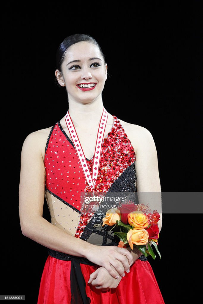 Gold medalist Kaetlyn Osmond of Canada listens to the national anthem during the medal ceremony for the ladies competition at the 2012 Skate Canada International ISU Grand Prix event in Windsor on October 27, 2012. AFP PHOTO/Geoff Robins