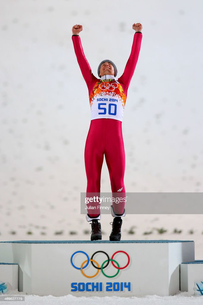 Gold medalist <a gi-track='captionPersonalityLinkClicked' href=/galleries/search?phrase=Kamil+Stoch&family=editorial&specificpeople=820513 ng-click='$event.stopPropagation()'>Kamil Stoch</a> of Poland celebrates on the podium during the flower ceremony after the Men's Large Hill Individual Final Round on day 8 of the Sochi 2014 Winter Olympics at the RusSki Gorki Ski Jumping Center on February 15, 2014 in Sochi, Russia.